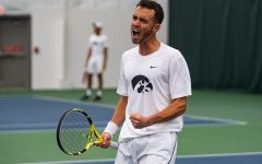 Iowa's Kareem Allaf celebrates a point during a men's tennis match between Iowa and Western Michigan at the HTRC on Saturday, Jan. 18, 2020. The Hawkeyes defeated the Broncos, 4-3.