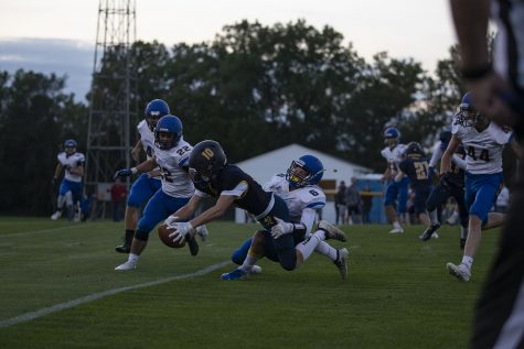Regina's Alec Wick is tackled during a varsity football game with Wapello High School at Regina Catholic Education Center on Friday, Sept. 18, 2020 in Iowa City. The Regals defeated the Indians with a score 43-16. (Hannah Kinson/The Daily Iowan)