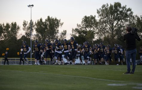 Regina's football team runs onto the field before a varsity football game with Wapello High School at Regina Catholic Education Center on Friday, Sept. 18, 2020 in Iowa City. The Regals defeated the Indians with a score 43-16.