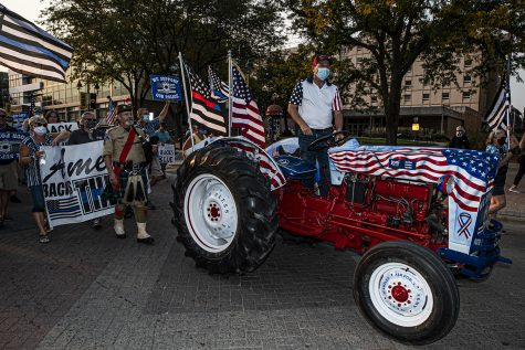Des Moines citizen Gary Leffler leads the Back the Blue march from his tractor on Friday, Sept. 25, 2020. Citizens marched through downtown Iowa City to show solidarity with the local police force. (Tate Hildyard/The Daily Iowan)