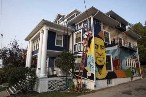 "The mural entitled ""Falling Upwards"" fills the south side of a home on Dubuque Street in Iowa City, Iowa on Friday, September 25, 2020. The mural, painted by Defy Studios of Minneapolis was commissioned by property owner Sam Stelter, a former University of Iowa student and Kappa-Sigma Beta-Rha member, who saw the mural as an opportunity to create conversation of individual experiences and the power of community."