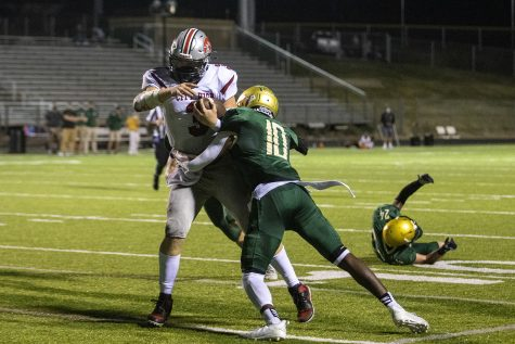 City quarterback Raphael Hamilton is taken down by West wide receiver Damarion Williams during a football game between Iowa City West and Iowa City High School at Iowa City West High School on Friday, Sept. 4, 2020. The Trojans defeated the Little Hawks 56-20.