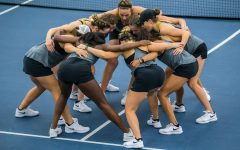 Iowa players huddle before doubles play during a women's tennis match between Iowa and Maryland at the HTRC on Sunday, April 7, 2019. The Hawkeyes defeated the Terrapins, 6-1.