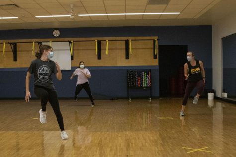 Instructor Rachel Cole teaches a Strong by Zumba class at the CRWC on Friday, Sept. 11, 2020.