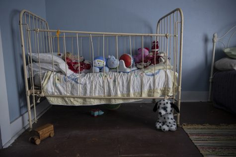 A crib full of toys is seen in the children's upstairs bedroom inside of the Villisca Ax Murder House in Villisca, Iowa on Sept. 30, 2020. Villisca is the site of one of the oldest cold cases in Iowa in which eight people were murdered in their beds. The killer was never found, sparking many theories and interest in the case. On the night of the killings, this room was occupied by all of the Moore children. The crib now sits filled with toys.