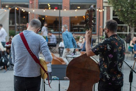 Blake Shaw and Dan Padley perform outside Goosetown Cafe on Tuesday Oct. 7, 2020. Guests watched from their tables outside as others gathered within the street to listen.