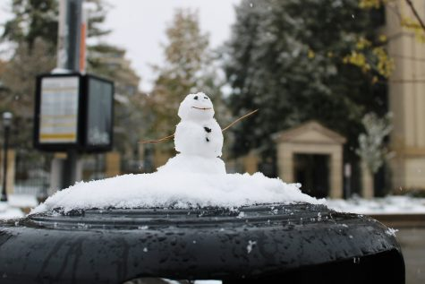 An anonymous snowman is seen on top of a trash can on Monday, Oct. 19, 2020.