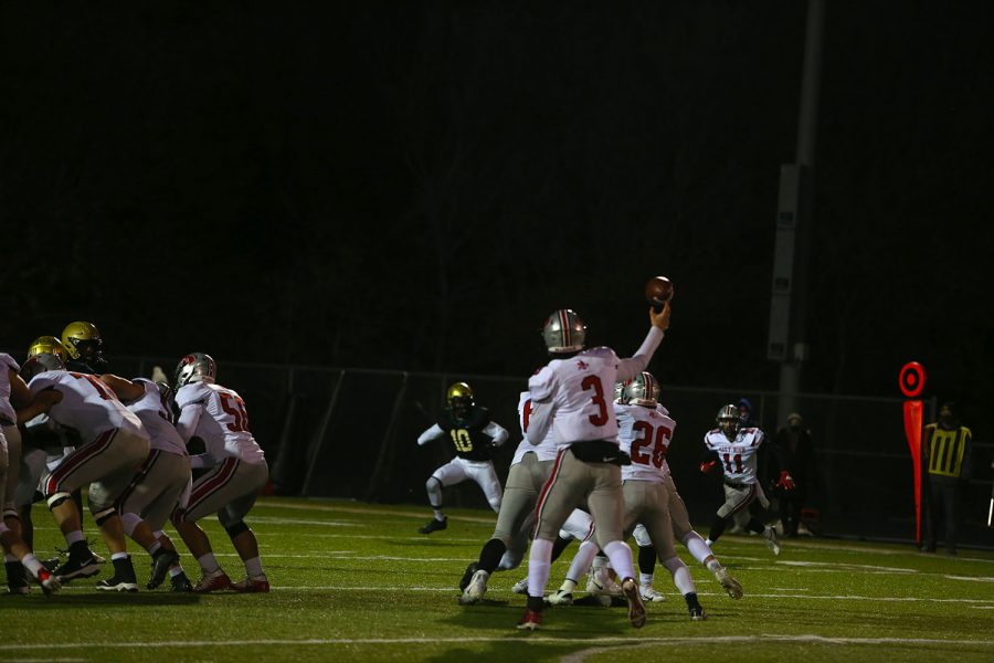 Iowa City High's quarterback Raph Hamilton throws the ball down field during the Iowa City West vs. Iowa City High on Friday, October 23, 2020. Iowa City West defeated Iowa City High 35-7.