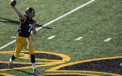 Iowa Quarterback Spencer Petras throws a pass during the Iowa v Northwestern football game at Kinnick Stadium on Saturday, Oct. 31, 2020.  The Wildcats defeated the Hawkeyes 21-20.