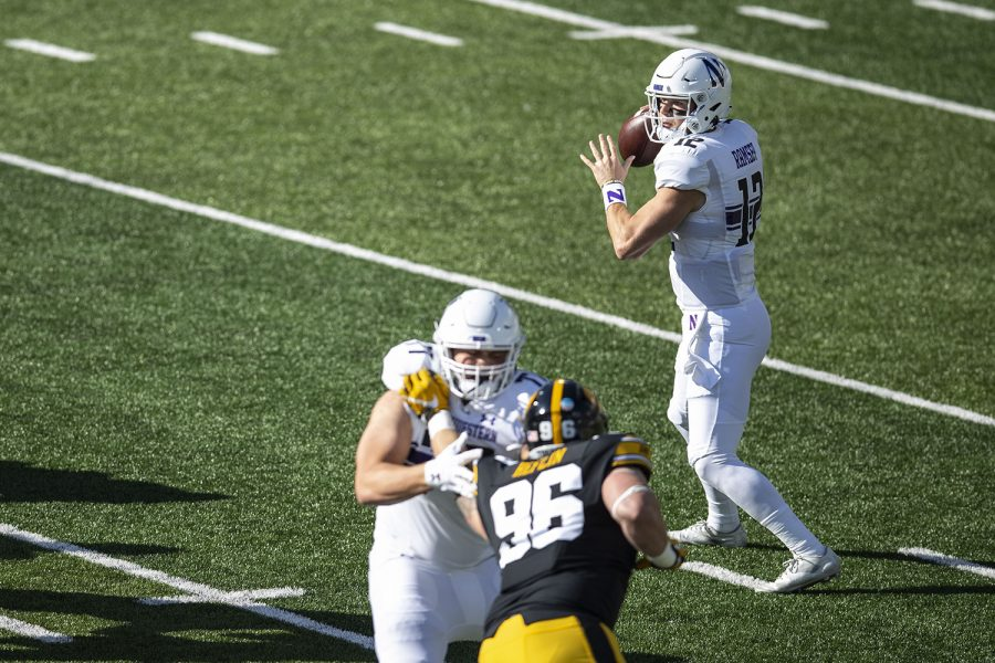 Northwestern Quarterback Peyton Ramsey looks to throw a pass during the Iowa v Northwestern football game at Kinnick Stadium on Saturday, Oct. 31, 2020.  The Wildcats defeated the Hawkeyes 21-20.