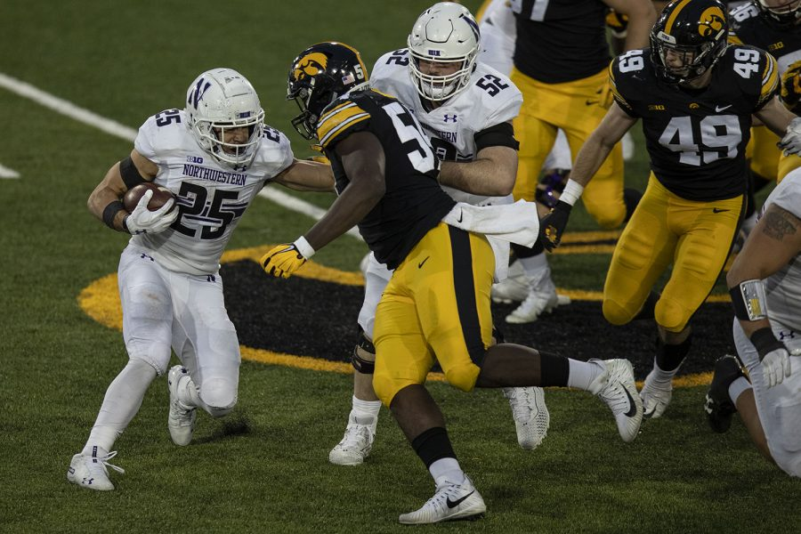 Iowa Defensive Tackle Daviyon Nixon goes to block Northwestern Running Back Isaiah Bowser during the Iowa v Northwestern football game at Kinnick Stadium on Saturday, Oct. 31, 2020.  The Wildcats defeated the Hawkeyes 21-20.