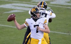 West Lafayette, Indiana, USA; Iowa Hawkeyes quarterback Spencer Petras (7) passes the ball in the second quarter against the Purdue Boilermakers at Ross-Ade Stadium on Saturday, Oct. 24, 2020. (Trevor Ruszkowski - USA Today)