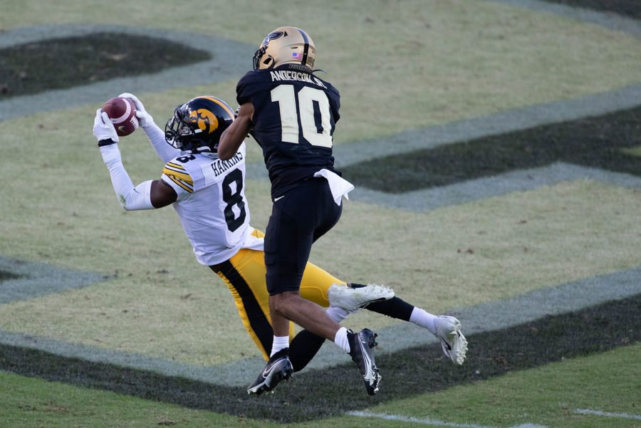 West Lafayette, Indiana, USA; Iowa Hawkeyes defensive back Matt Hankins (8) intercepts the ball in front of Purdue Boilermakers wide receiver Amad Anderson Jr. (10) in the second quarter at Ross-Ade Stadium on Saturday, Oct. 24, 2020. (Trevor Ruszkowski-USA TODAY).