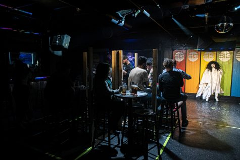 Studio 13 Patrons enjoy a drag show with drag queen, Beep Beep in downtown Iowa City on Friday, Oct. 9, 2020. As of this weekend, the government mandated closing of bars has been lifted prompting an upswing of business as locals and students return.