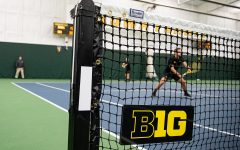 Iowa's Joe Tyler prepares to serve during a men's tennis match between Iowa and Creighton at the HTRC on Saturday, Jan. 18, 2020.