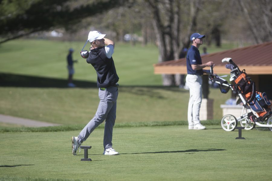 Benton Weinberg takes a starting shot during a golf invitational at Finkbine Golf Course on Saturday, April 20, 2019. Iowa came in first with a score of 593 against 12 other teams.