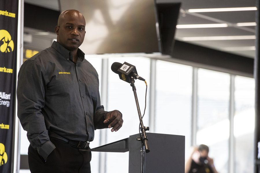 Wide Receivers coach Kelton Copeland walks up to the podium to address members of the press during football media day in Kinnick Stadium on Thursday, Oct. 8, 2020. Copeland and all Iowa coaches wore masks until they reached the podium six feet from the first row of chairs.
