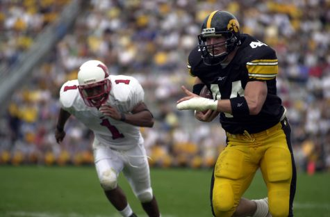 Hawkeye Dallas Clark rushes the endzone for a touchdown against the Redhawks during the third quarter of the Hawkeye