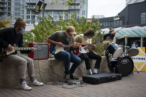The local band known as Ped Mall play outside of Daydrink coffee shop in downtown Iowa City on Saturday, October 17, 2020.