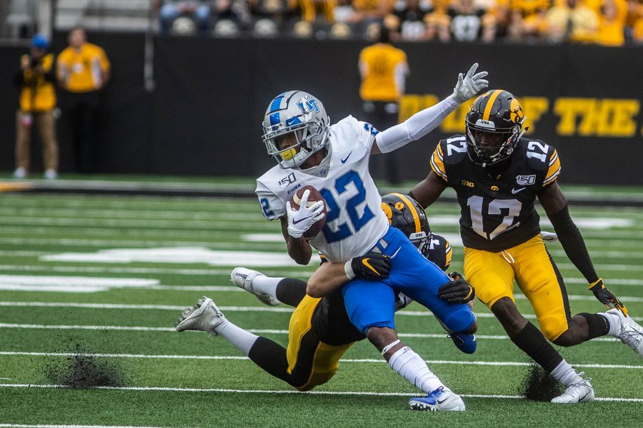 Iowa linebacker Seth Benson tackles MTSU wide receiver DJ England Middle Chisolm during a football game between Iowa and Middle Tennessee State University on Saturday, September 28, 2019. The Hawkeyes defeated the Blue Raiders 48-3.
