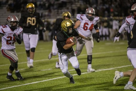 West High running back Trey King avoids defenders during the Iowa City West football game against Iowa City High on Friday, Oct. 23, 2020. The Trojans defeated the Little Hawks 35-7. (Katie Goodale/The Daily Iowan)