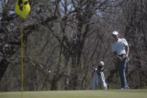 Joe Kim watches the ball approach the flag during a golf invitational at Finkbine Golf Course on Saturday, April 20, 2019. Iowa came in first with a score of 593 against 12 other teams.