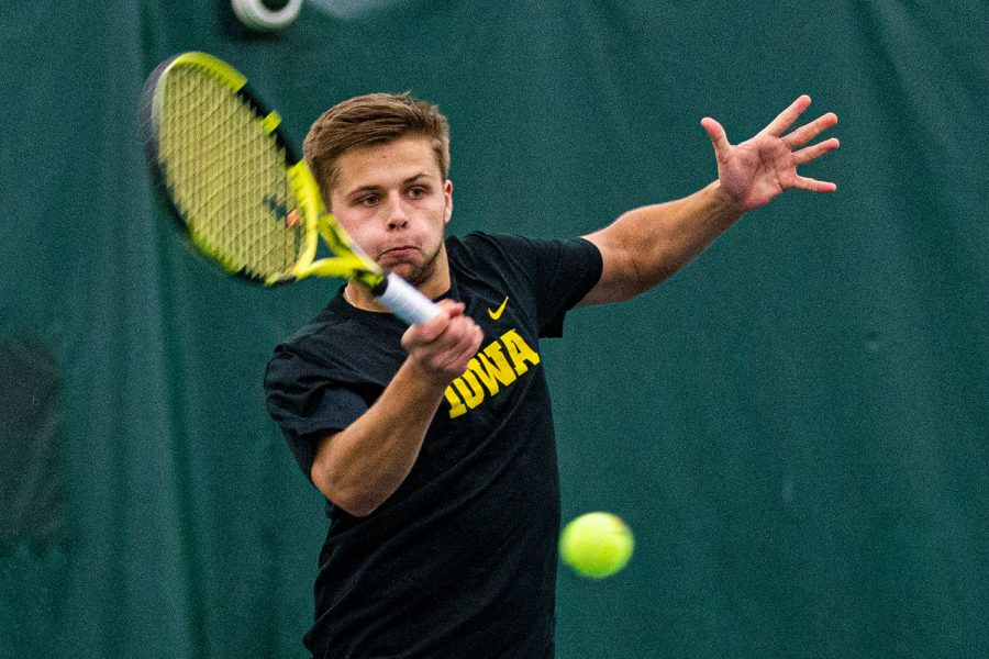 Iowa's Will Davies hits a forehand during a men's tennis match between Iowa and Texas Tech at the HTRC on Thursday, Jan. 16, 2020. The Red Raiders defeated the Hawkeyes, 4-3.