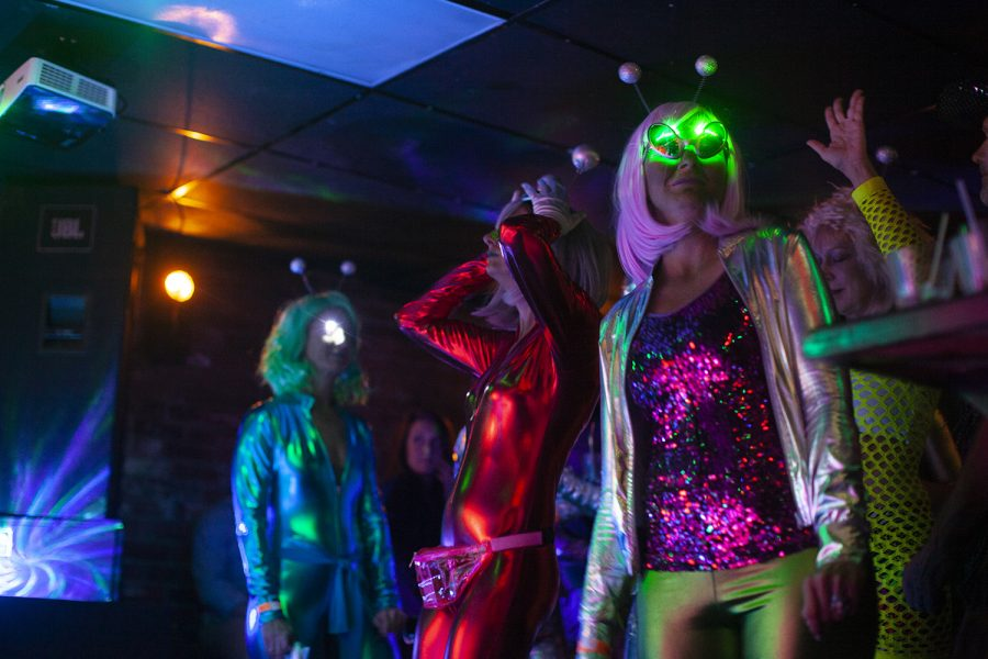 Attendees+dance+in+alien+costumes+during+Undercover+Organism%E2%80%99s+set+at+Yacht+Club+on+Saturday%2C+Oct.+26%2C+2019.+Many+members+of+the+crowd+sported+Halloween+costumes+for+the+occasion.