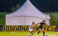 Iowa defender Riley Whitaker navigates the field during a women's soccer match between Iowa and Western Michigan on Thursday, August 22, 2019. The Hawkeyes defeated the Broncos, 2-0.