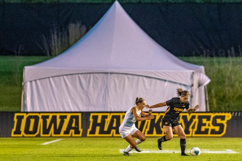 Iowa defender Riley Whitaker navigates the field during a women