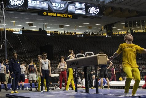 Athletes warm up during day two of the Big Ten Men