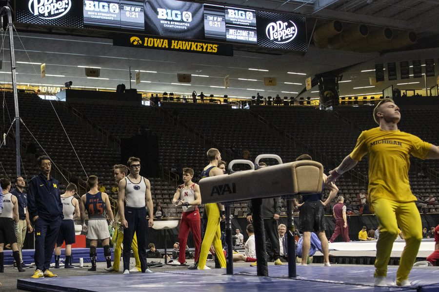 Athletes warm up during day two of the Big Ten Men's Gymnastics Championships in Carver-Hawkeye Arena on April 6, 2019. Gymnasts competed in individual competitions.
