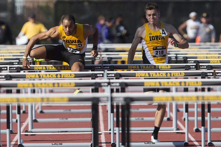 Iowa's Aaron Mallett clears a hurdle alongside teammate Chris Douglas during the 18th annual Musco Twilight at Francis X. Cretzmeyer Track on Saturday, April 22, 2017. Iowa's men and women's track and field finished first overall in the Musco Twilight with a 237.5 and 203 respectively.