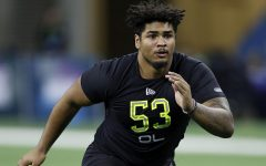 Iowa offensive lineman Tristan Wirfs runs a drill during the NFL Combine at Lucas Oil Stadium in Indianapolis on Feb. 28, 2020. (Joe Robbins/Getty Images/TNS)