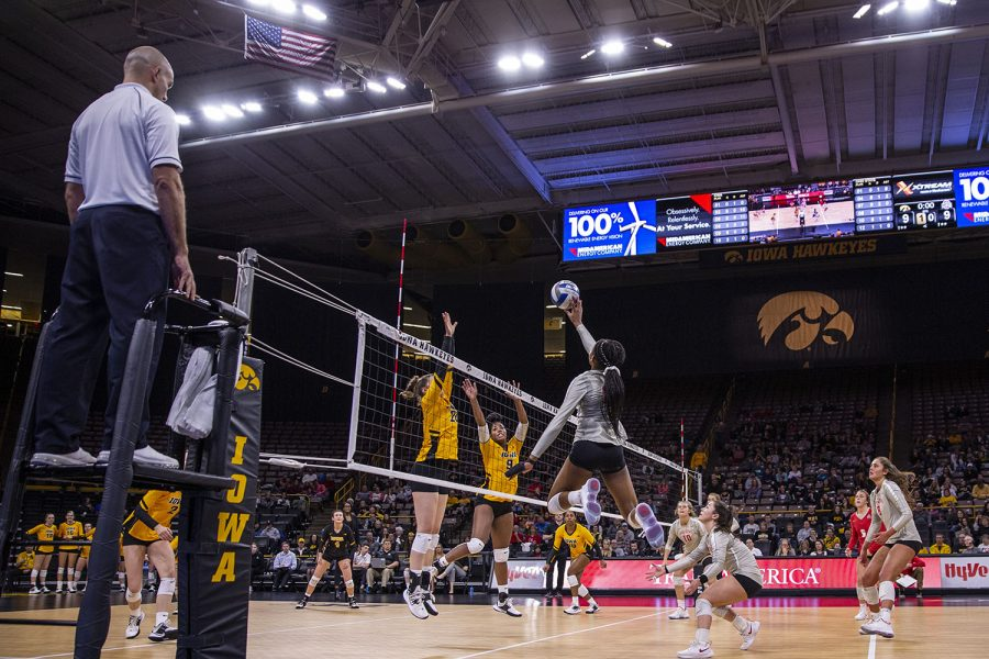 Ohio outside hitter Jenaisya Moore hits the ball to the Iowa side during a volleyball match between the University of Iowa and Ohio State University at Carver Hawkeye Arena on Friday, November 29, 2019. The Buckeyes defeated the Hawkeyes 3-1.