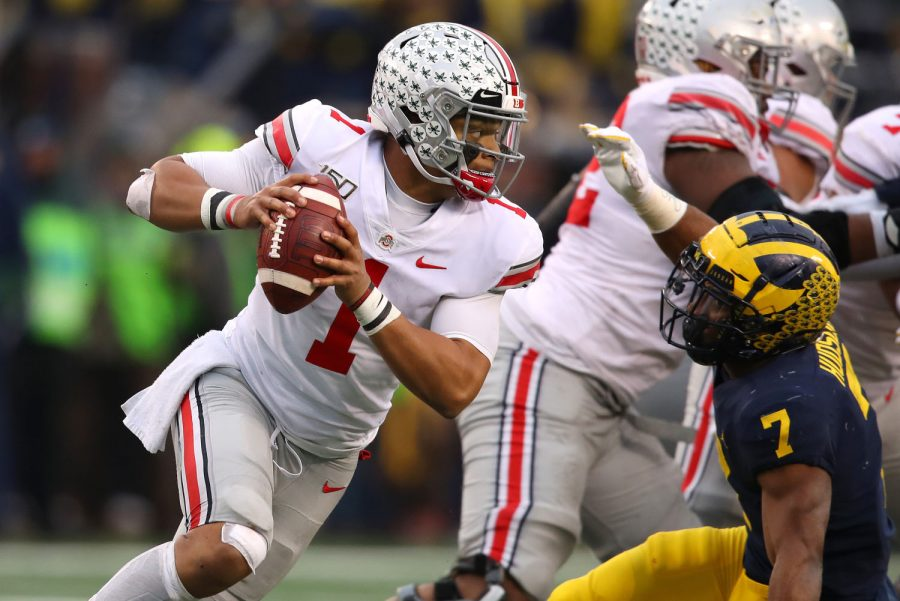 Justin Fields (1) of the Ohio State Buckeyes tries to get around the tackle of Khaleke Hudson (7) of the Michigan Wolverines during the second half at Michigan Stadium on November 30, 2019 in Ann Arbor, MI. Fields was one of the proponents of restarting the Big Ten conference amind COVID-19 pandemic. (Gregory Shamus/Getty Images/TNS)