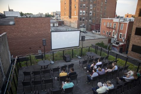 Moviegoers wait for a screening of La La Land to begin on the rooftop of Filmscene on Sunday, July 7, 2019.