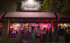 Brother's Bar and Grill is seen on Thursday Oct. 8, 2020, the first weekend of bars reopening. Governor Kim Reynolds released a proclamation last Friday allowing bars to reopen in Johnson and Story counties on Monday, Oct. 5. Many bar-goers were out without masks on and there was little social distancing in lines.
