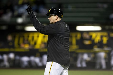 Iowa head coach Rick Heller gestures to his team during a baseball game between Iowa and Grand View at Duane Banks Field on March 3, 2020. The Hawkeyes defeated the Vikings 15-2.