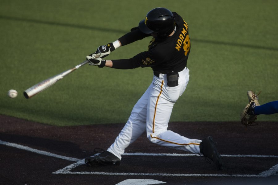 Iowa outfielder Ben Norman swings on a pitch during a baseball game between the Iowa Hawkeyes and the Kansas Jayhawks on Tuesday, March 10, at Duane Banks Field. The Hawkeyes defeated the Jayhawks, 8-0.