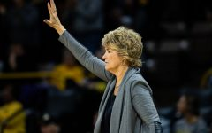 Iowa head coach Lisa Bluder calls a formation during a women's basketball match between Iowa and Indiana at Carver-Hawkeye Arena on Sunday, Jan. 12, 2020. The Hawkeyes defeated the Hoosiers, 91-85, in double overtime.