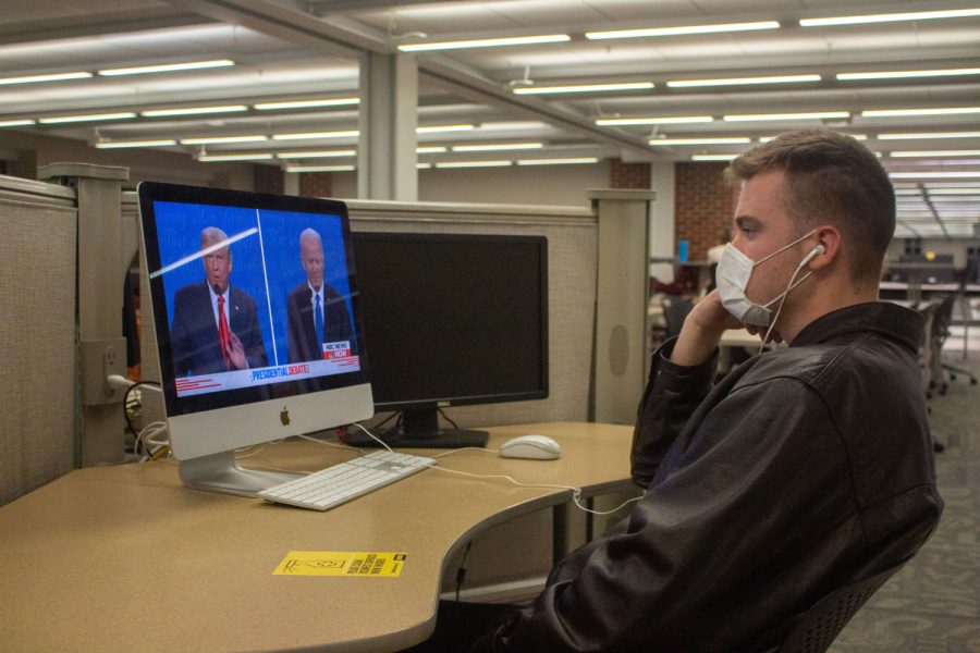 """President Donald Trump and former Vice President Joe Biden face off in the final Presidential Debate of 2020 as University of Iowa senior, Trevor Johnson, watches in the Main Library on Thursday, Oct. 22, 2020. Johnson said, """"I want to see what is going to happen in this debate and if it is going to be a circus…so far it hasn't been too bad."""" He went on to say, """"They haven't he'd the need to really mute their mics, but we'll see what happens the rest of the debate. The most important thing is that they remain civil and presidential."""""""