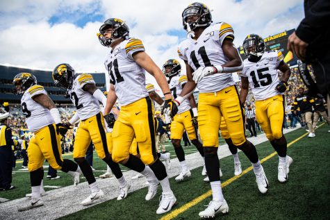 Iowa players take the field during a football game between Iowa and Michigan in Ann Arbor on Saturday, October 5, 2019. The Wolverines celebrated homecoming and defeated the Hawkeyes, 10-3.