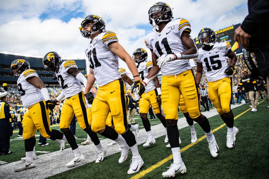 Iowa+players+take+the+field+during+a+football+game+between+Iowa+and+Michigan+in+Ann+Arbor+on+Saturday%2C+October+5%2C+2019.+The+Wolverines+celebrated+homecoming+and+defeated+the+Hawkeyes%2C+10-3.+