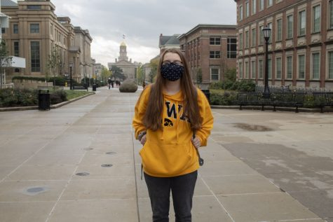 Freshman Tara Kielkopf poses on the T. Anne Cleary Walkway on Oct. 22, 2020. Kielkopf, like many other freshmen, has not had a typical start to college due to COVID-19. Freshmen are utilizing student organizations, social media, and many virtual methods to find a sense of a community during the pandemic.