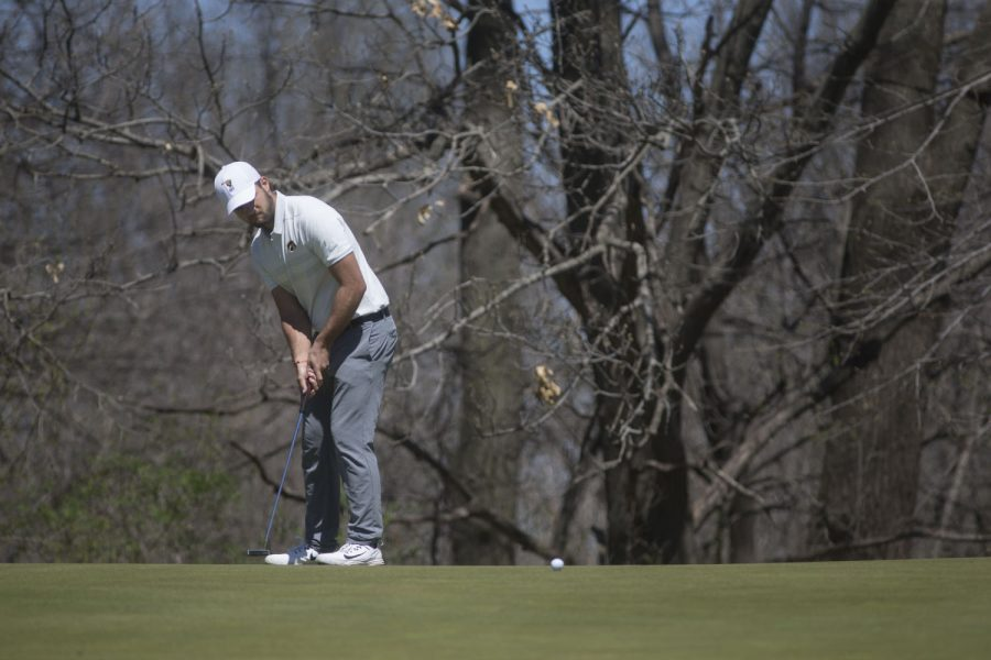 Gonzalo Leal putts during a golf invitational at Finkbine Golf Course on Saturday, April 20, 2019. Iowa came in first with a score of 593 against 12 other teams.