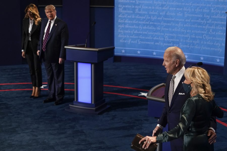 From left, first lady Melania Trump, President Donald Trump, Democratic presidential candidate former Vice President Joe Biden and his wife, Jill Biden, stand on stage following the conclusion of the first presidential debate at the Health Education Campus of Case Western Reserve University in Cleveland on September 29, 2020.