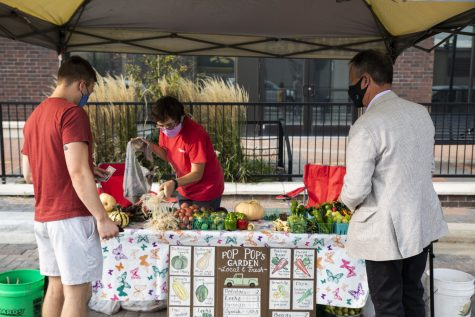 Customers purchase fresh produce at the Coralville Farmers Market 201 E. 9th St. on Monday, Sept. 14, 2020.