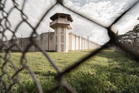 Prison with iron fences. Prison or jail is a building where people are forced to live if their freedom has been taken away. Prison is the building use for punishment prisoner.