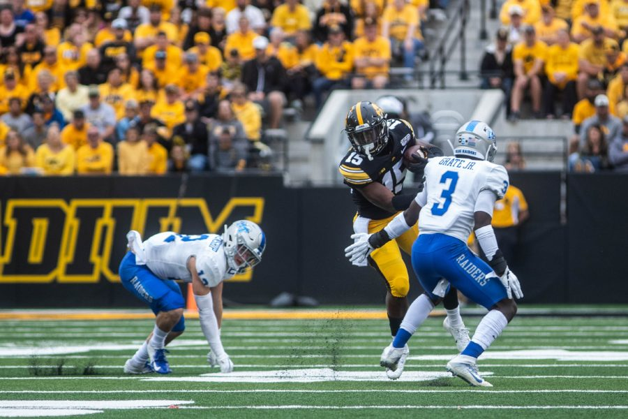 Iowa running back Tyler Goodson breaks a tackle during a football game between Iowa and Middle Tennessee State University on Saturday, September 28, 2019. The Hawkeyes defeated the Blue Raiders 48-3.